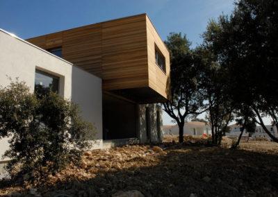 Maison ossature légère acier après habillage bois et crépi