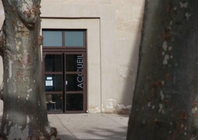 Porte d'entrée acier à deux battants vitrée