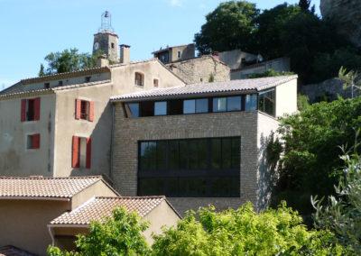 Surélévation de maison en ossature légère métallique en coeur de ville après habillage